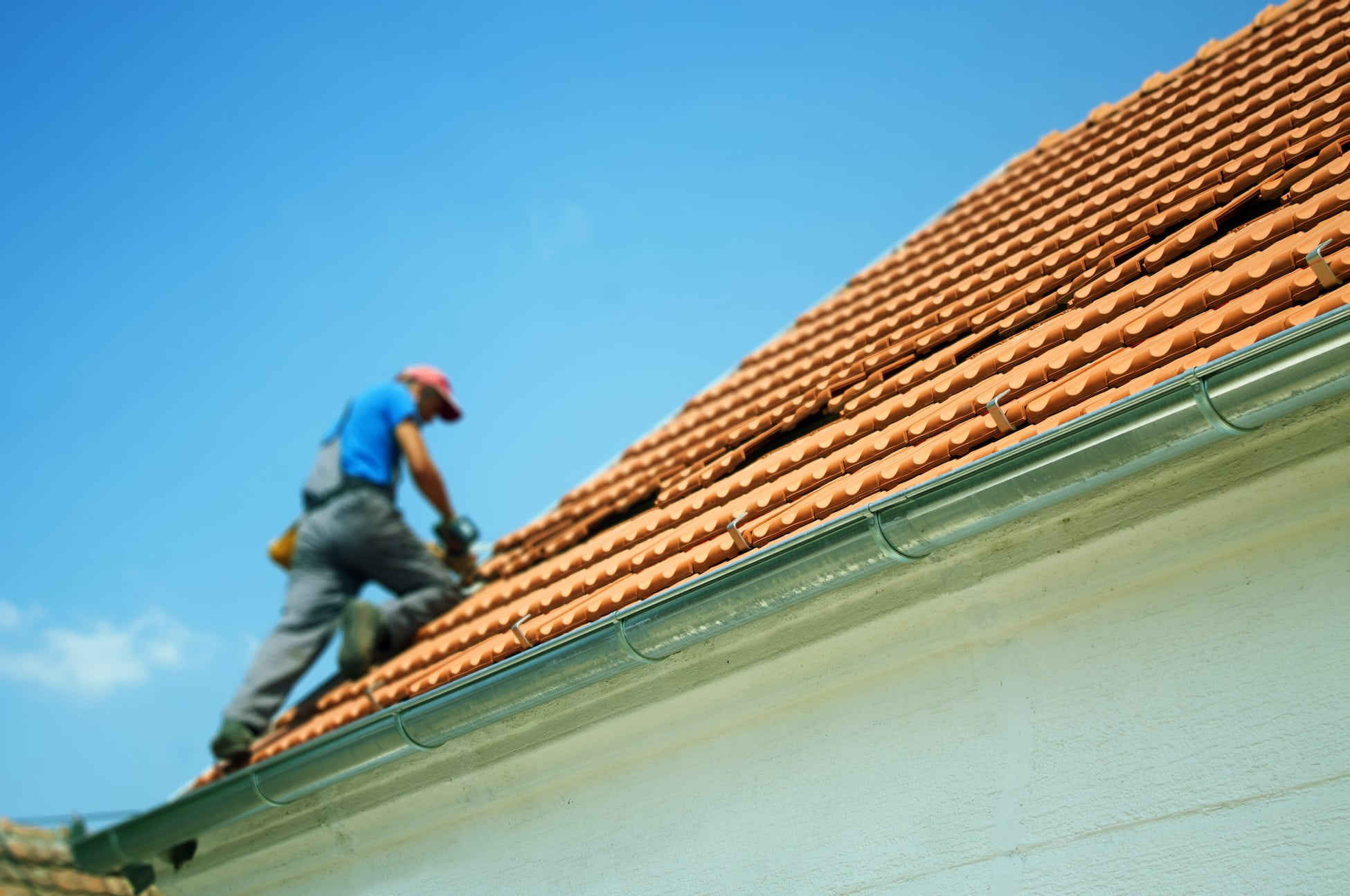 repairing a clay tile residential roof